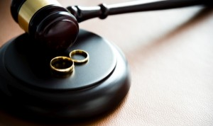 Gavel and wedding rings, for divorce concept.